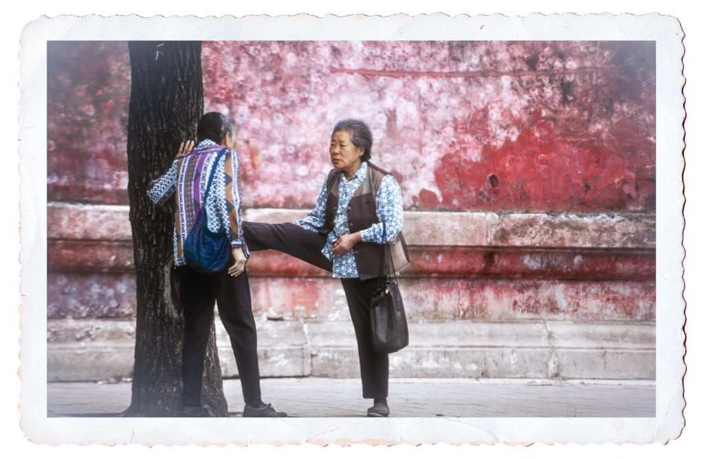 Postcard photograph of two elderly ladies chatting while exercising, Beijing, China