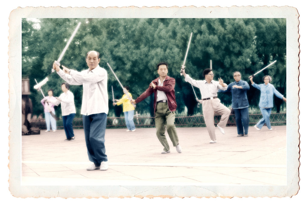 Hand-tinted photo of early morning Tai Chi sword class in China