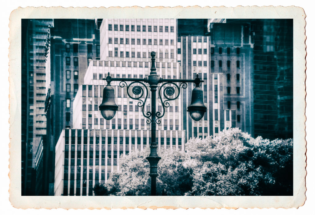 Postcard black and white photo of a wrought iron street lamp in New York City