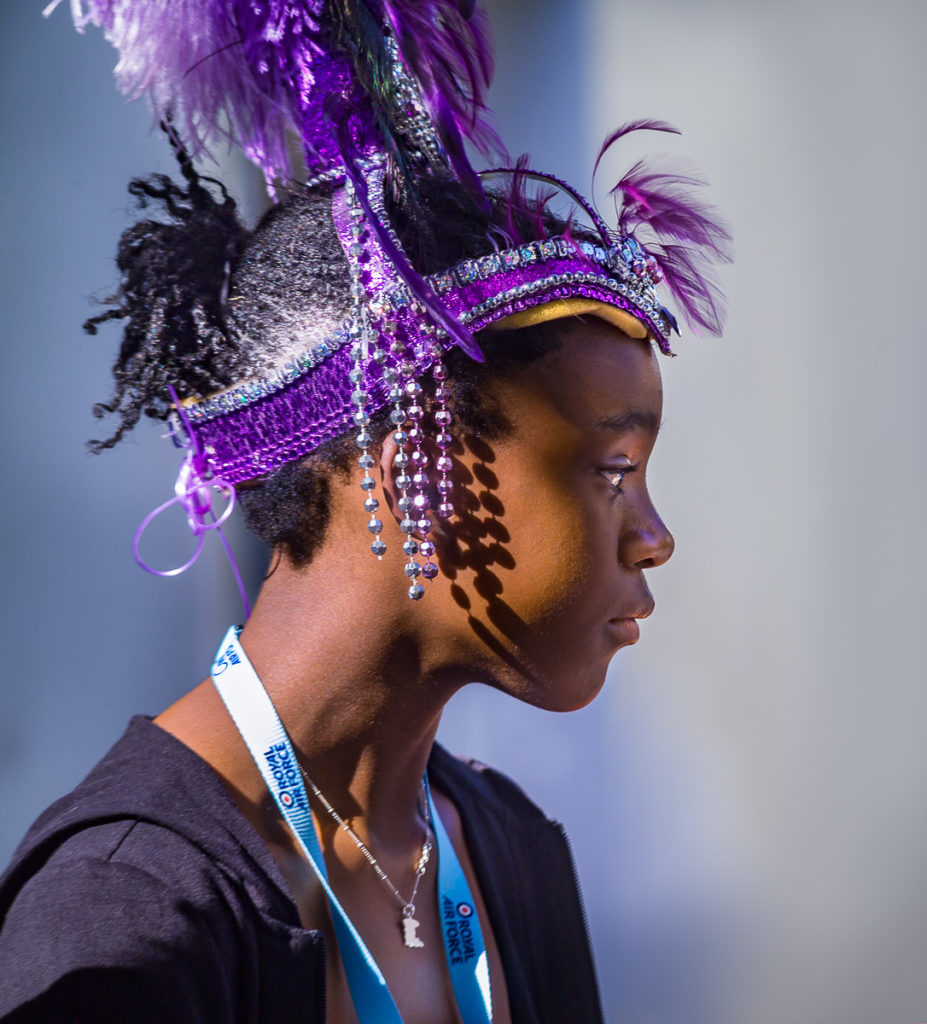 Photo of Girl in purple head dress at Notting Hill Carnival, London