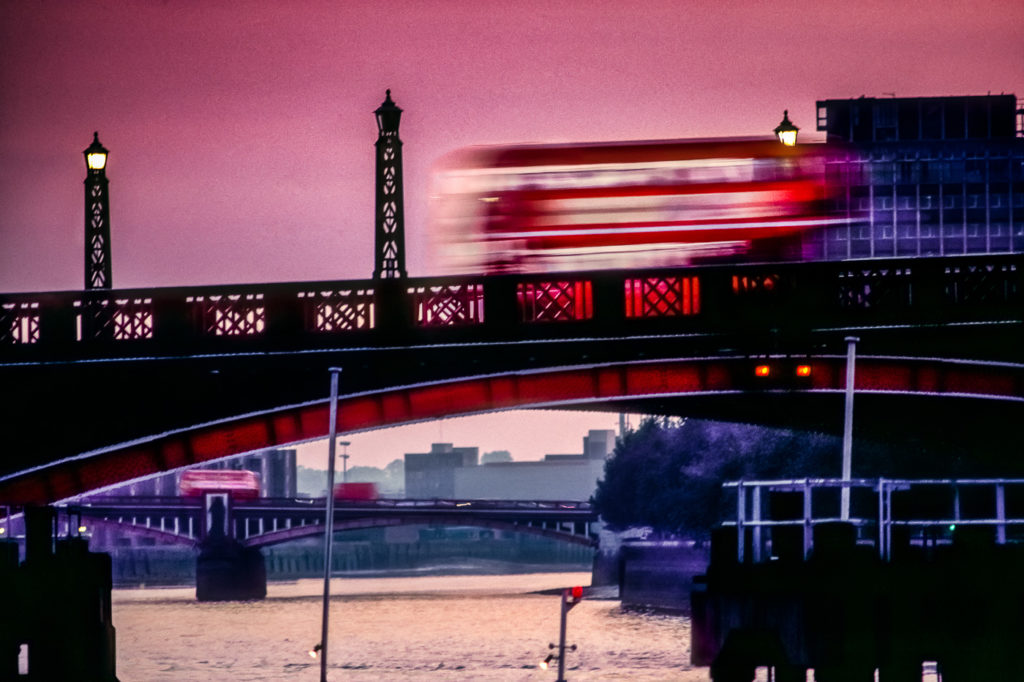 Photo of London Red Bus going over Lambeth Bridge, Central London, England