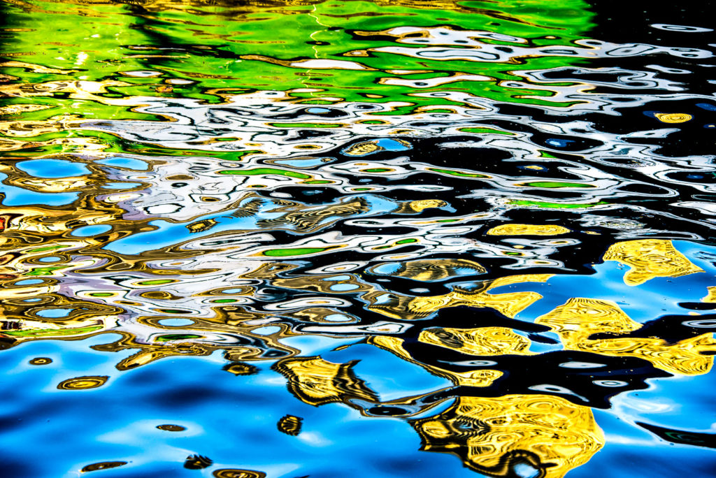 Colour Photograph of rippling circles of reflection