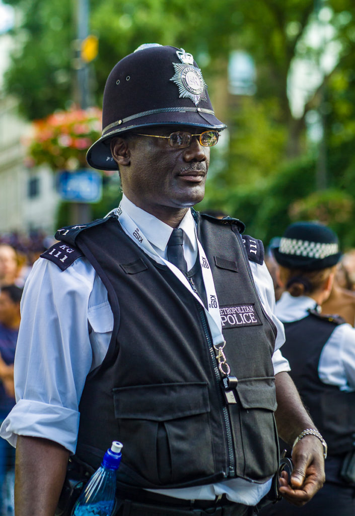 Photo of black Metropolitan Police office at Notting Hill Carnival, London